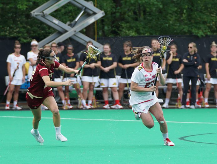 Two college athletes play in a lacrosse game