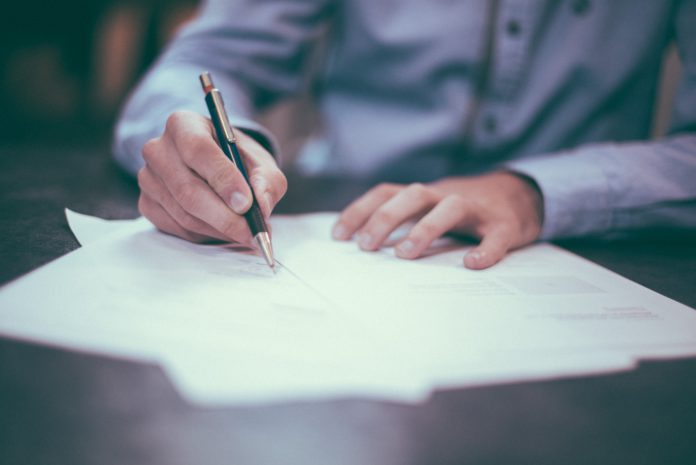 Lawyer drafts contracts