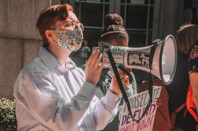 Pro-life protestors use a megaphone.