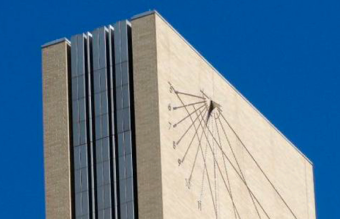 A sundial on the side of the Alfred A. Arraj U.S. Courthouse in Denver.