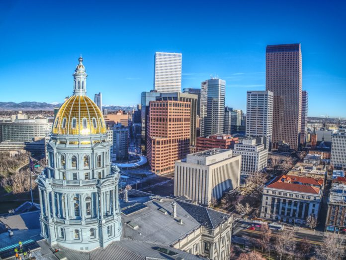 Colorado state capitol and skyscrapers in Denver