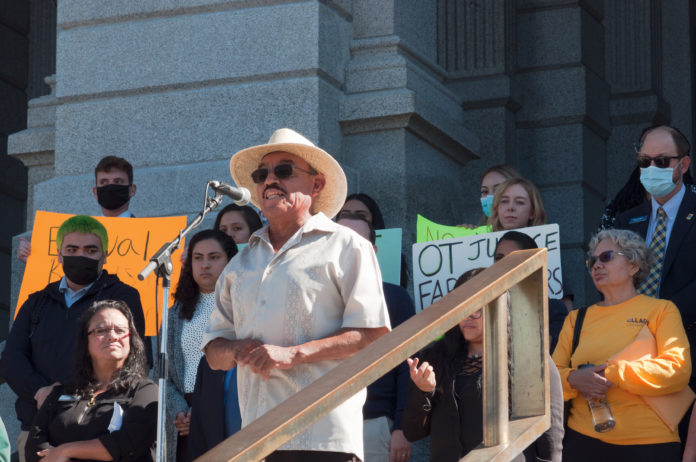 Adolfo Hernandez Atilano speaks to a crowd at the Colorado State Capitol